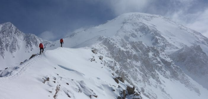 Two mountaineers ascend the West Buttress route on Denali at approximately 16,600'. Credit: Steve House